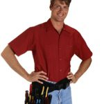 Electrician Standing with hands on hips